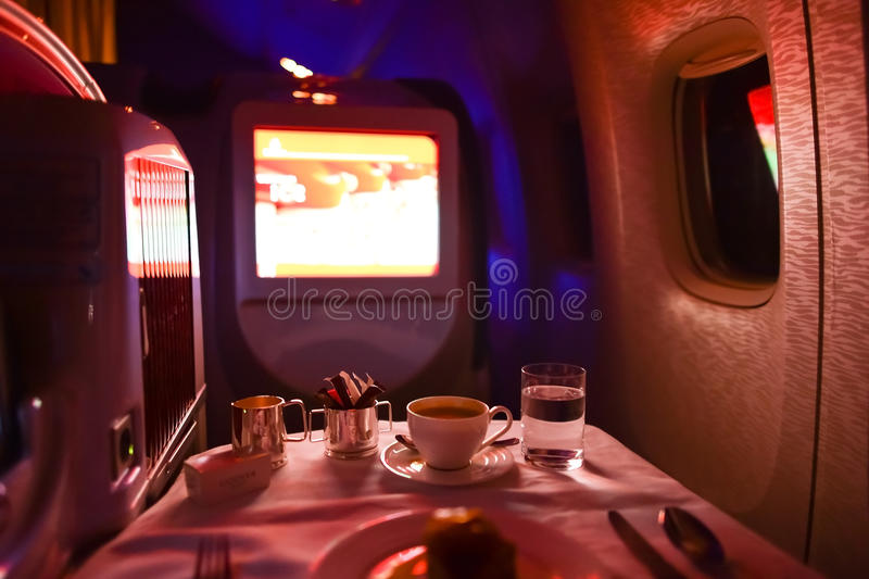 Emirates first class Boeing-777 interior. MOSCOW, RUSSIA - MARCH 30, 2015: Emirates first class Boeing-777 interior. Emirates is one of two flag carriers of the stock image