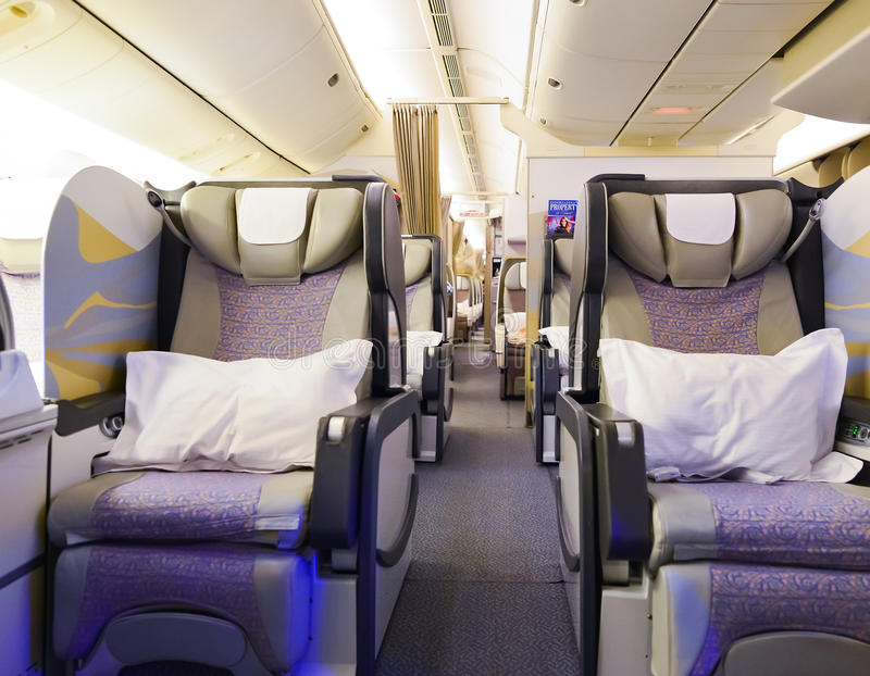 Emirates first class Boeing-777 interior. MOSCOW, RUSSIA - MARCH 30, 2015: Emirates first class Boeing-777 interior. Emirates is one of two flag carriers of the stock photos