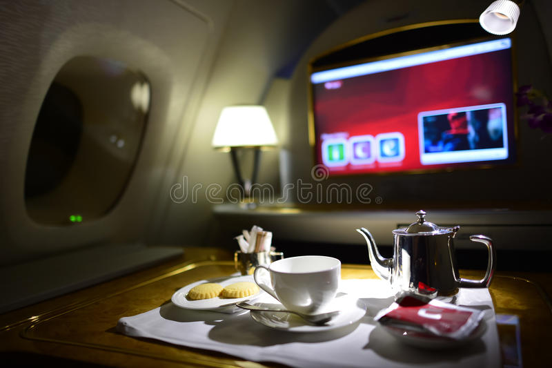 Emirates first class interior. DUBAI, UAE - MARCH 31, 2015: Emirates first class interior. Emirates is one of two flag carriers of the United Arab Emirates along stock images