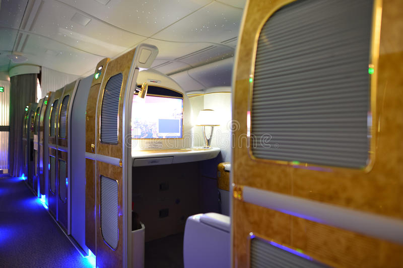 Emirates first class interior. DUBAI, UAE - MARCH 31, 2015: Emirates first class interior. Emirates is one of two flag carriers of the United Arab Emirates along stock photo