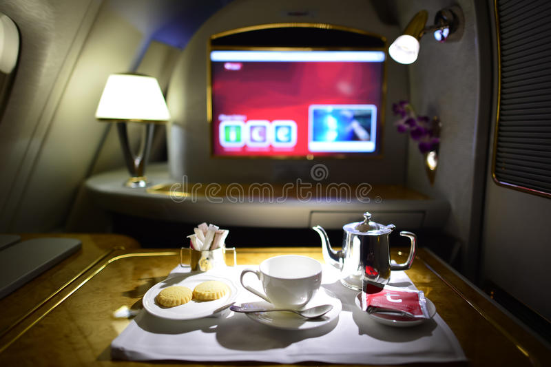 Emirates first class interior. DUBAI, UAE - MARCH 31, 2015: Emirates first class interior. Emirates is one of two flag carriers of the United Arab Emirates along royalty free stock image