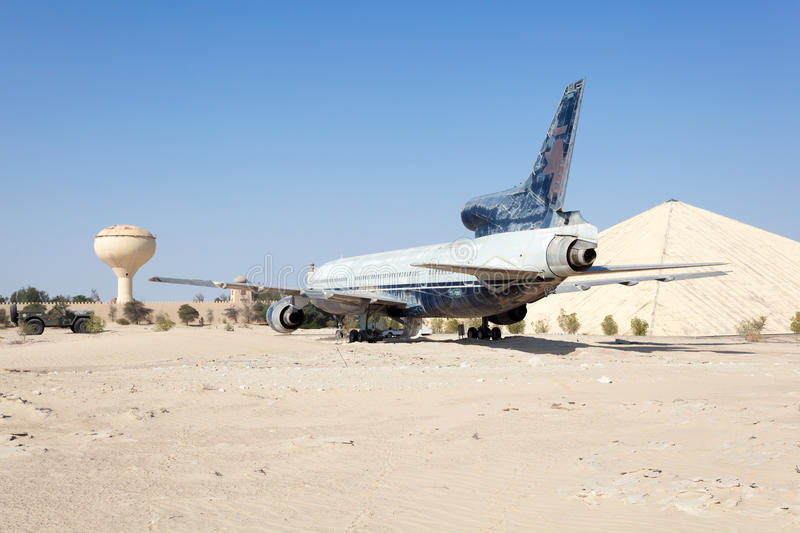Emirates National Auto Museum in Abu Dhabi. ABU DHABI - DEC 22: Airplane in the desert at the Emirates National Auto Museum in Abu Dhabi. December 22, 2014 in stock photos