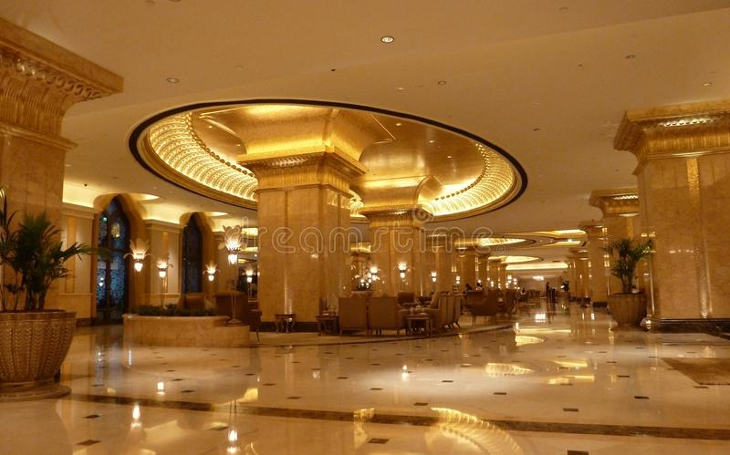 Emirates Palace interior of golden style. Doric like capital of column in new golden style with 24 carat gold plated oval top slab enlargement with ornamental stock photography