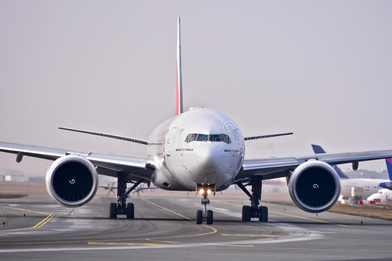 Emirates plane B777. This is a view of Emirates plane Boeing 777-300ER registered as A6-EQA on the Warsaw Chopin Airport royalty free stock photos