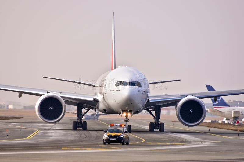 Emirates plane B777. This is a view of Emirates plane Boeing 777-300ER registered as A6-EQA on the Warsaw Chopin Airport stock image