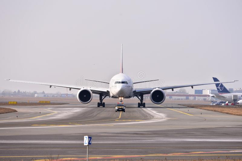Emirates plane B777. This is a view of Emirates plane Boeing 777-300ER registered as A6-EQA on the Warsaw Chopin Airport stock photography