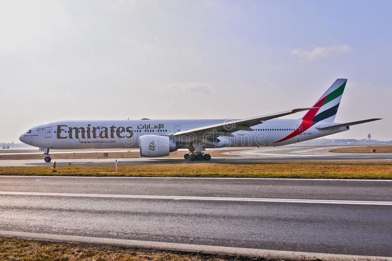 Emirates plane B777. This is a view of Emirates plane Boeing 777-300ER registered as A6-EQA on the Warsaw Chopin Airport royalty free stock photo