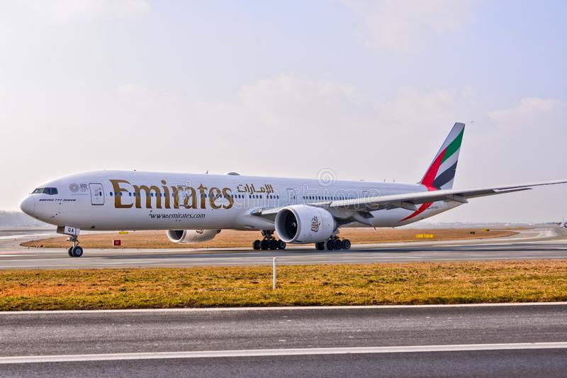 Emirates plane B777. This is a view of Emirates plane Boeing 777-300ER registered as A6-EQA on the Warsaw Chopin Airport stock photos