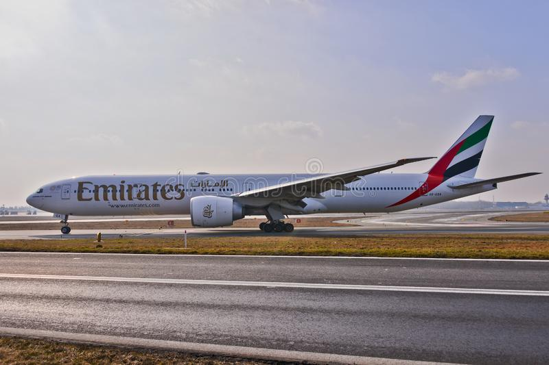 Emirates plane B777. This is a view of Emirates plane Boeing 777-300ER registered as A6-EQA on the Warsaw Chopin Airport royalty free stock image