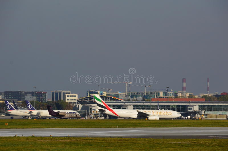 Emirates plane on the Warsaw Chopin Airport. This is a view of landing planes on the Warsaw Chopin Airport. October 6, 2014, Warsaw Chopin Airport in Warsaw royalty free stock image