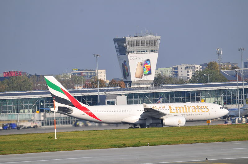 Emirates plane on the Warsaw Chopin Airport. This is a view of landing planes on the Warsaw Chopin Airport. October 6, 2014, Warsaw Chopin Airport in Warsaw stock image