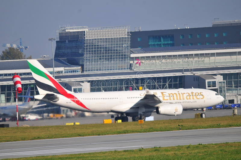 Emirates plane on the Warsaw Chopin Airport. This is a view of landing planes on the Warsaw Chopin Airport. October 6, 2014, Warsaw Chopin Airport in Warsaw royalty free stock photo