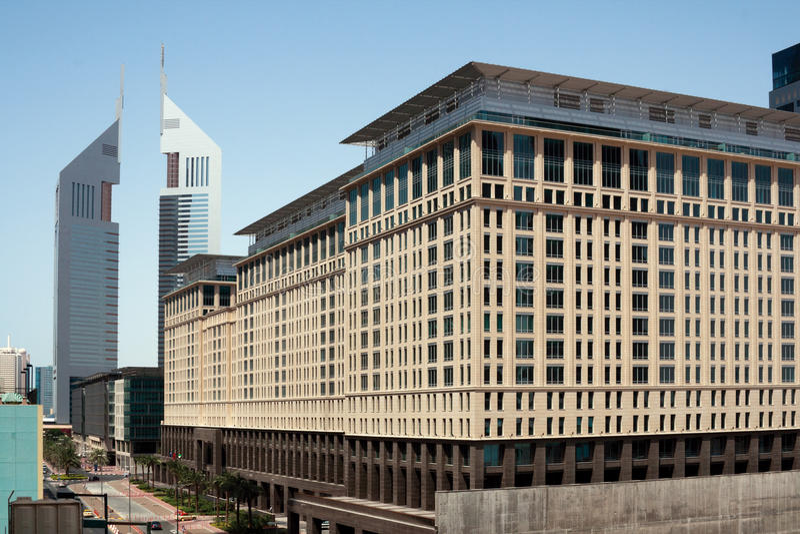 The Emirates Towers. Ritz-Carlton Hotel in front of the Emirates Towers, Dubai, United Arab Emirates stock photos