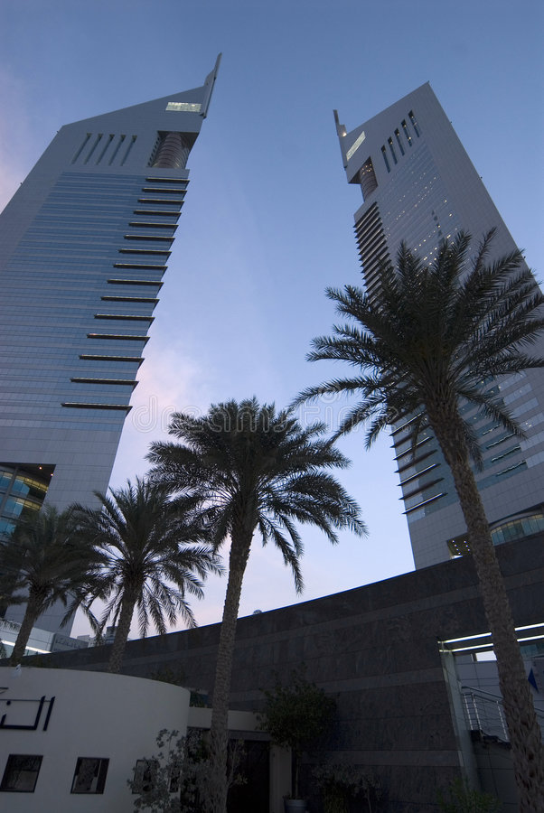 Emirates Towers at Dawn. The Emirates towers visible from the ground at dawn stock photos