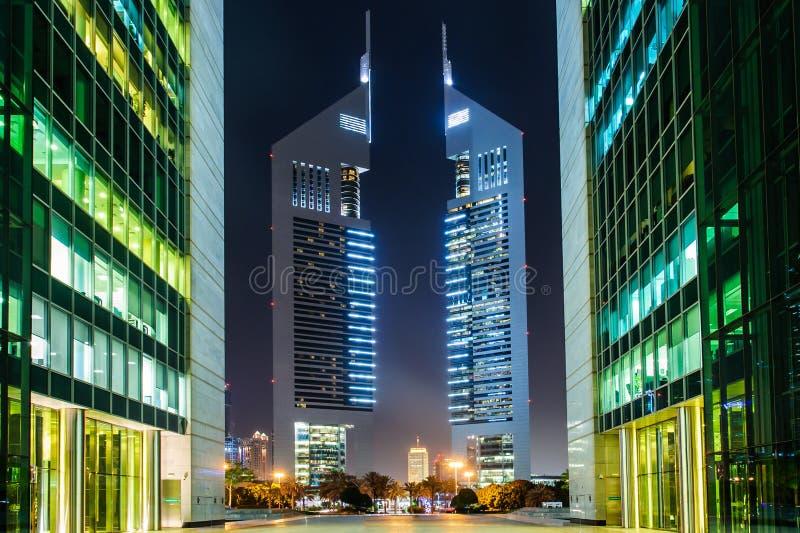 Emirates towers,Dubai,UAE. DUBAI - MAY 11: Emirates Towers at night time, 11 May 2014 in Dubai, UAE. Jumeirah Emirates Towers, Dubai's finest city hotel, is stock photos