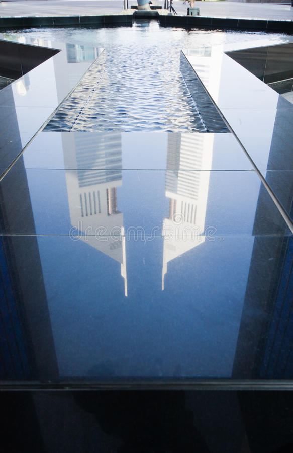 Emirates Towers, Dubai, UAE. Reflection of in water fountain royalty free stock photos