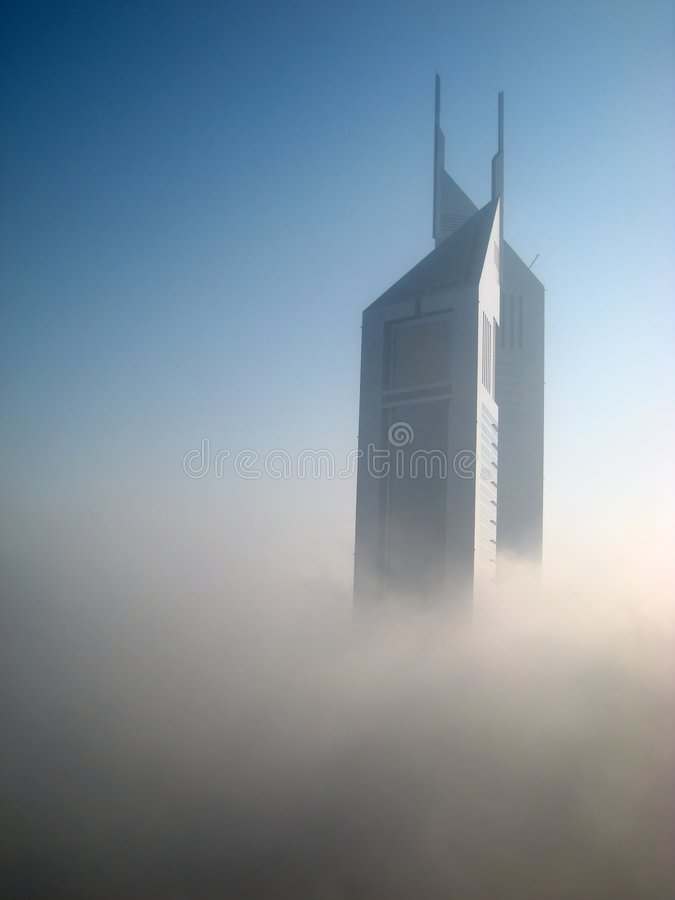 Emirates Towers in Fog. The Emirates Towers stand in fog in Dubai, United Arab Emirates royalty free stock photo
