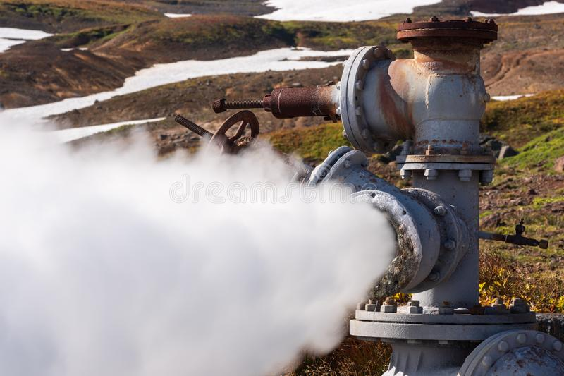 Emission of mineral geothermal water, steam from geological well. Emission of natural mineral thermal water, steam-water mixture from geological well in stock photos