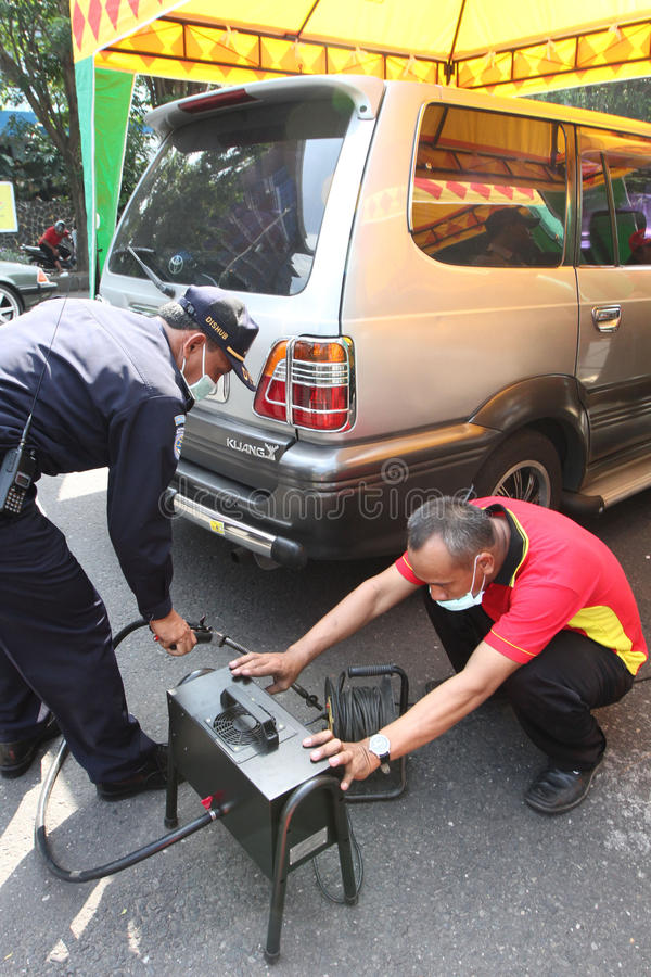 Emission test. Officers transportation agencies conduct emission tests on vehicles in the city of Solo, Central Java, Indonesia stock image