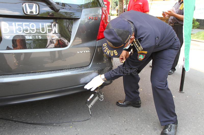 Emission test. Officers transportation agencies conduct emission tests on vehicles in the city of Solo, Central Java, Indonesia royalty free stock image