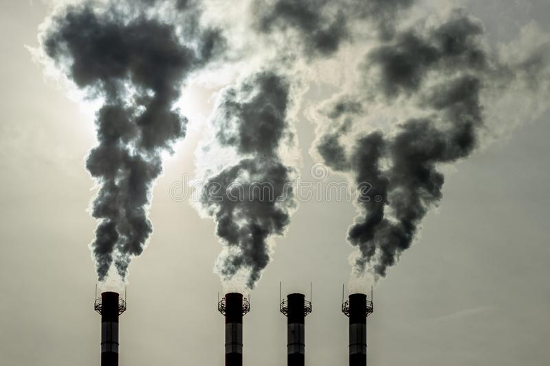 Emission of toxic fumes from the pipes into the atmosphere. Air pollution environmental problem, environmental pollution. Emission of toxic fumes from the pipes stock image