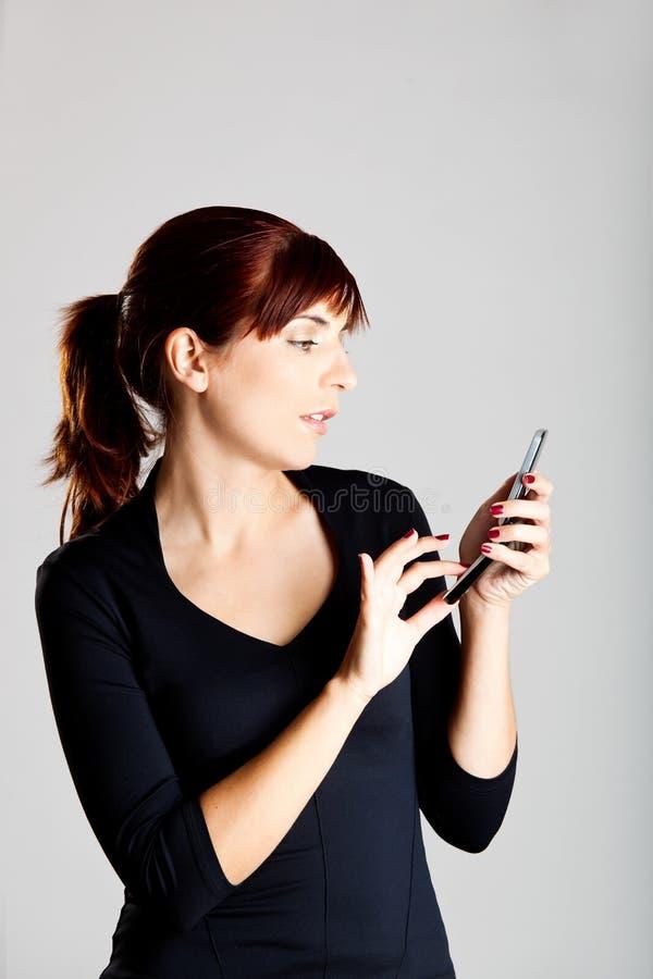 Emitindo um SMS fotografia de stock royalty free