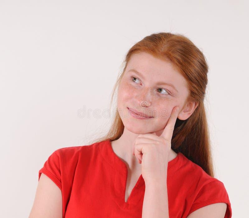 Emitonal bonito novo que levanta o adolescente no fundo cinzento imagem de stock royalty free