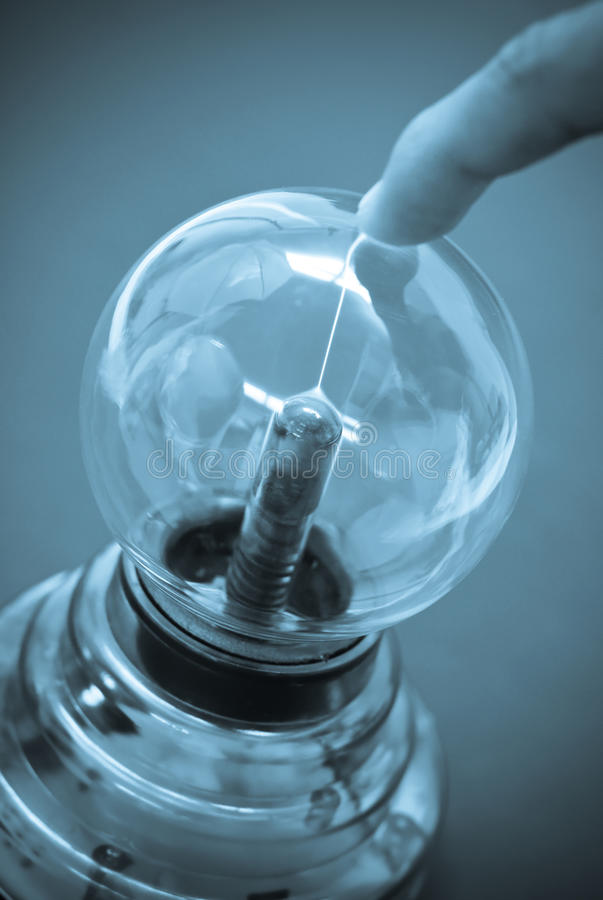 Emitting Electric Current. Tesla Coil Emitting Electric Current to a Finger stock images
