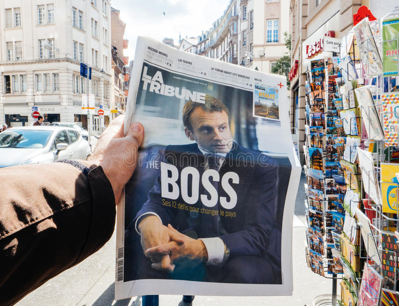 Emmanuel Macron The Boss. PARIS, FRANCE - MAY 15, 2017: Emmanuel Macron `The Boss` title on La Tribune newspaper reporting handover ceremony presidential royalty free stock photography