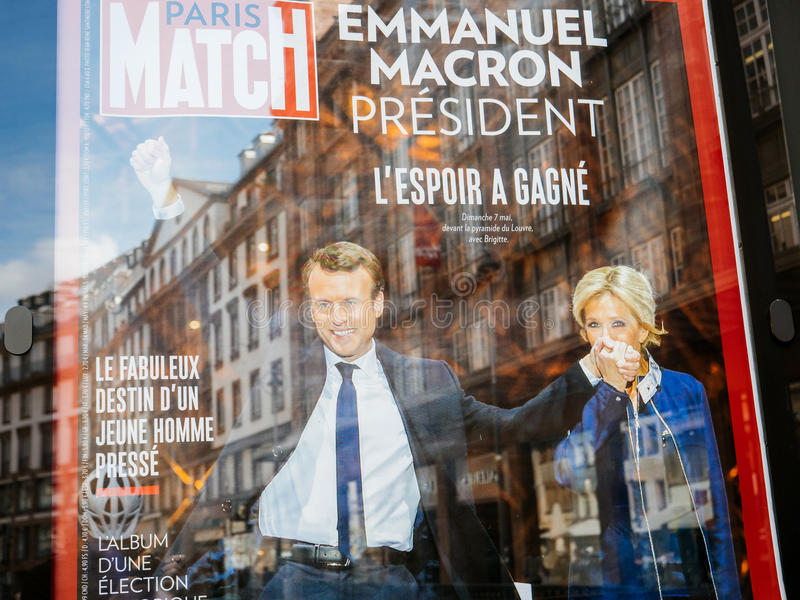 Emmanuel Macron with his wife Brigitte Trogneux on Paris Match p. STRASBOURG, FRANCE - MAY 15, 2017: French city press kiosk with Paris Match magazine with stock photos