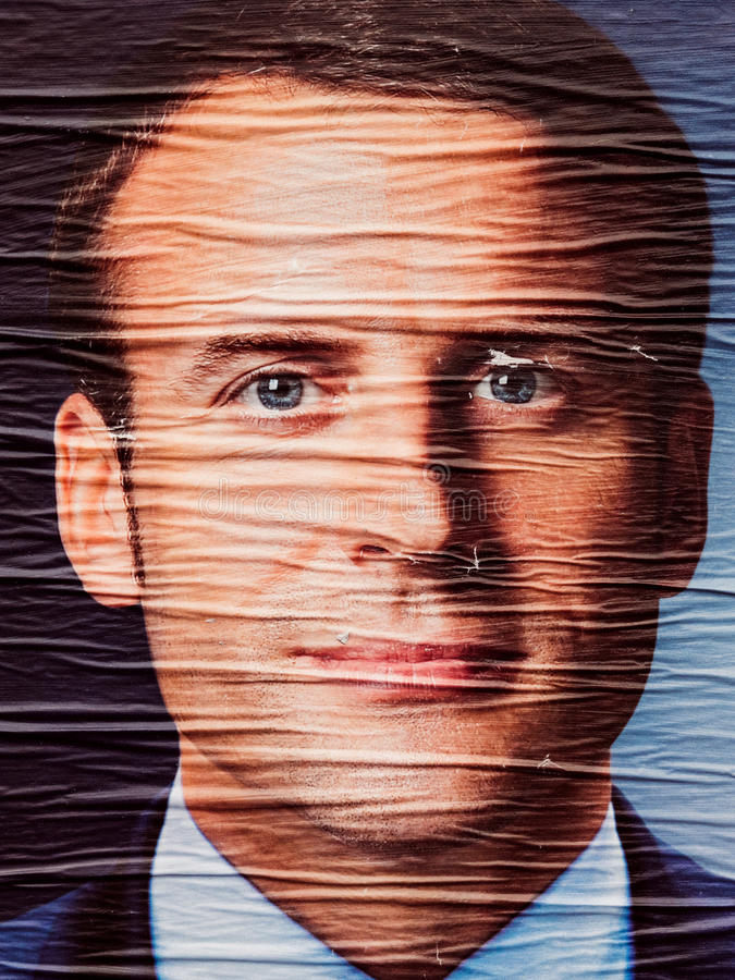 Emmanuel Macron portrait during Second round French Presidential. STRASBOURG, FRANCE - MAY 7, 2017: Emmanuel Macron portrait poster detail next to polling place royalty free stock photo