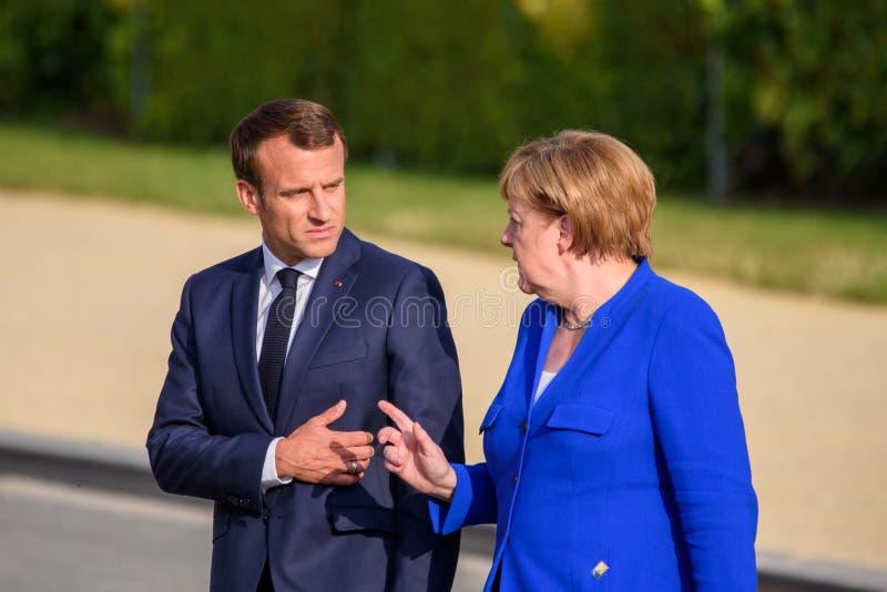 Emmanuel Macron president av Frankrike och Angela Merkel, kansler av Tyskland arkivfoto