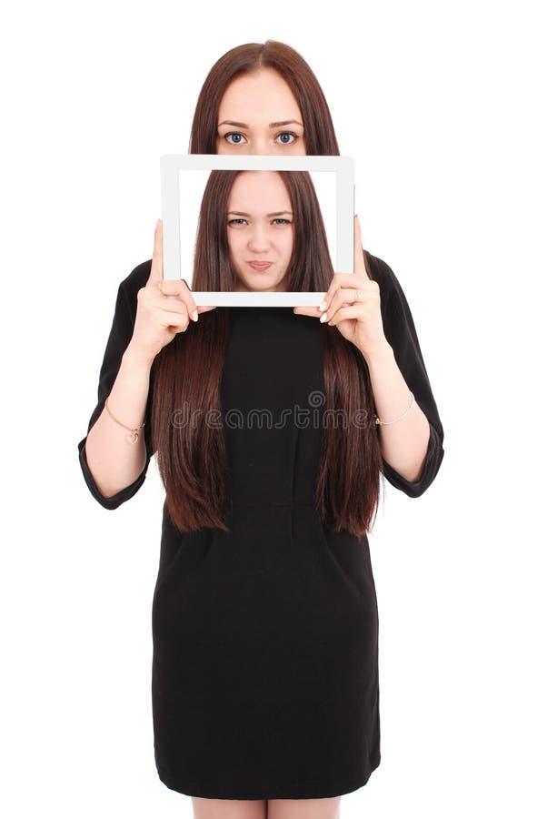 Emoções do adolescente Menina que mostra uma tela vazia da tabuleta imagens de stock royalty free