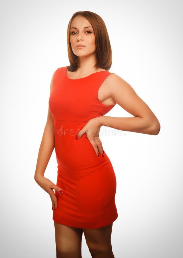 Emoción anaranjada del vestido de la mujer morena de la muchacha fotos de archivo