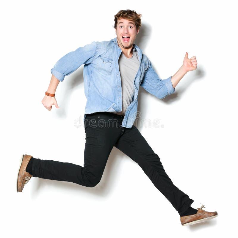Emocionado feliz de salto del hombre imagenes de archivo