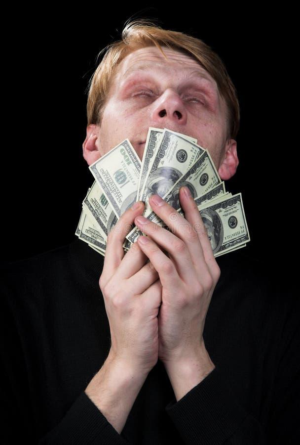 Emocional o homem e o dinheiro fotos de stock