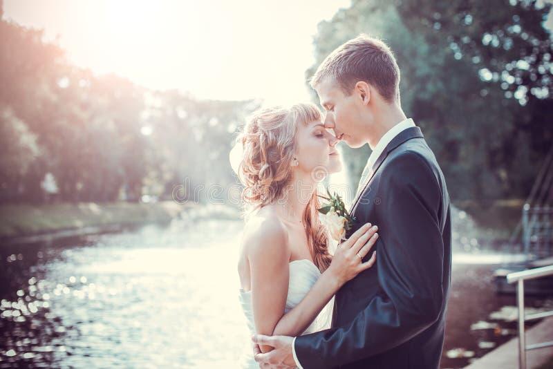 Emocional wedding kiss stock photography