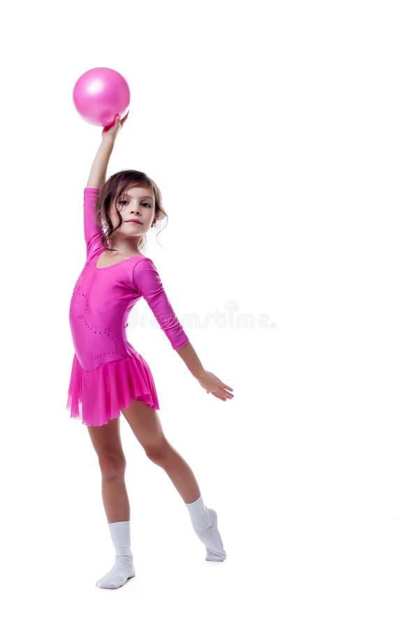 Emocjonalny mały gimnastyczka taniec z piłką zdjęcie stock