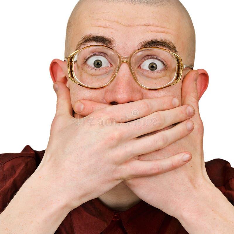 Emocjonalny z podnieceniem mężczyzna utrzymanie jego usta zamykający obrazy royalty free