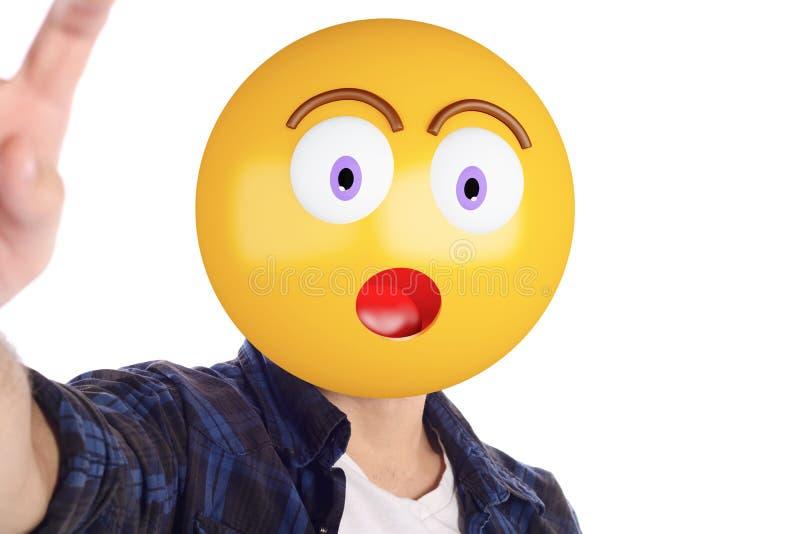 Emoji head man taking selfie. Portrait of an emoji head man taking selfie. Isolated white background stock photo