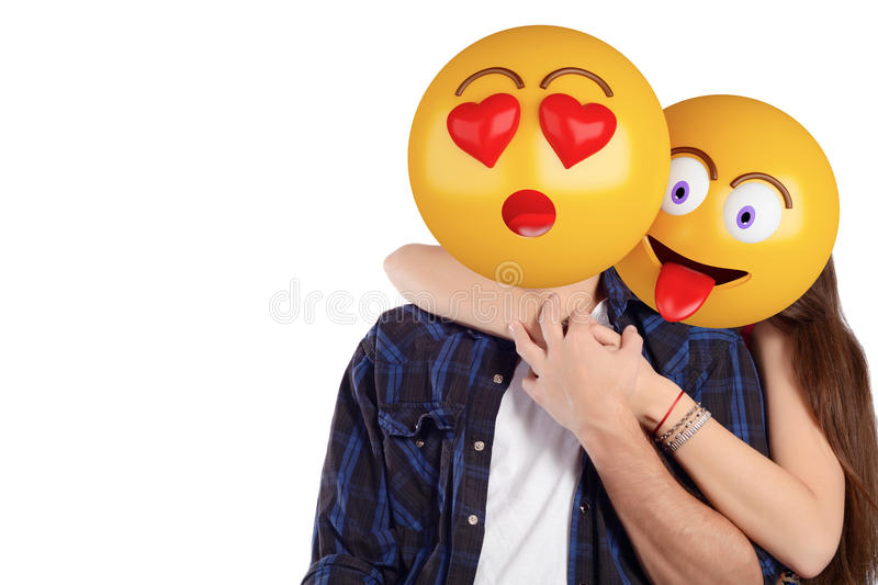 Emoji head man and woman. Beautiful couple. Portrait of an emoji head man and woman. Emoji and love concept. Isolated white background stock photography