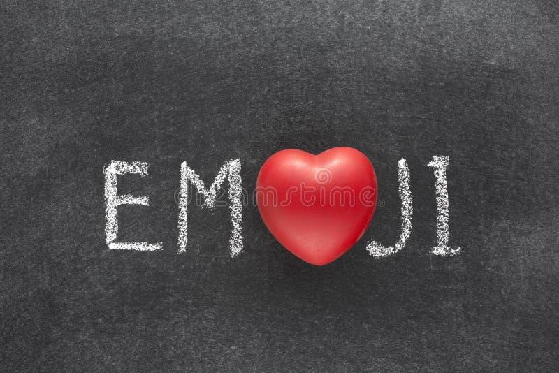 Emoji word heart. Emoji word handwritten on chalkboard with heart symbol instead of O stock photography