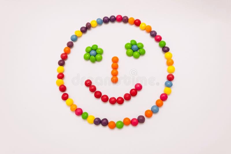 Emoticon del caramelo en el fondo blanco imágenes de archivo libres de regalías