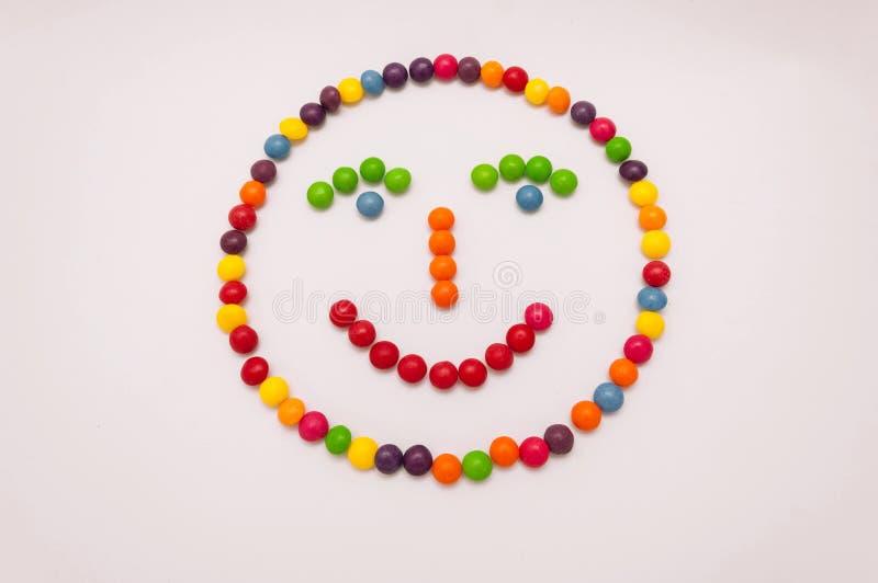 Emoticon del caramelo en el fondo blanco imagen de archivo libre de regalías