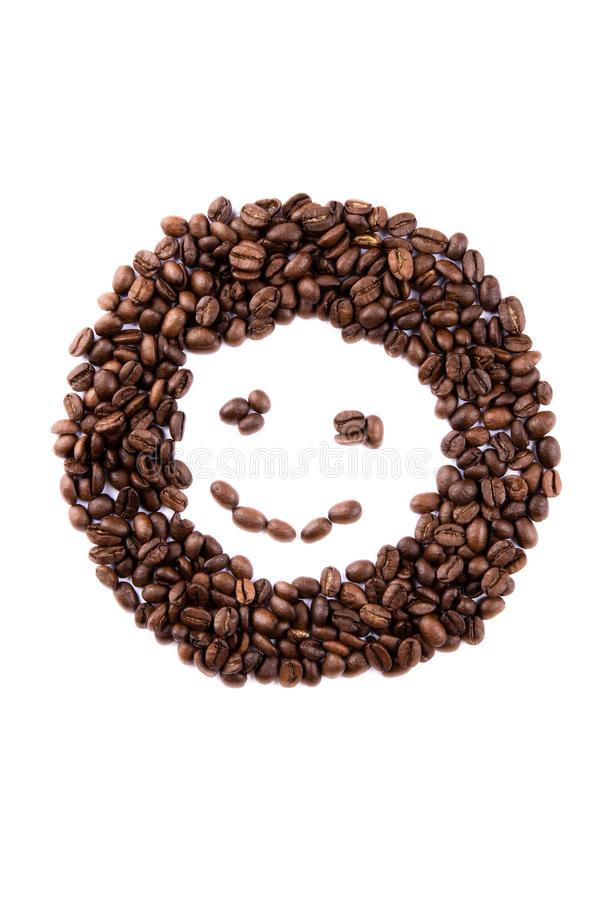 Emoticon face made of coffee beans on white backgroud with copyspace stock images