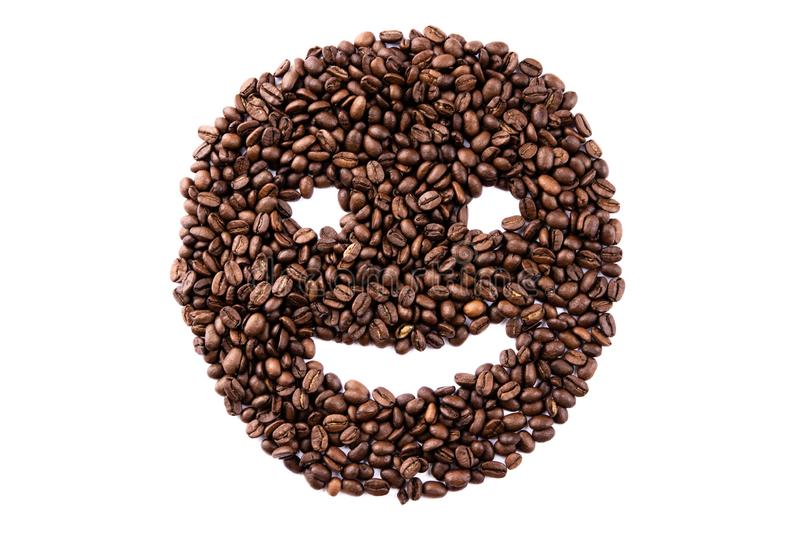 Emoticon face made of coffee beans on white backgroud with copyspace stock image