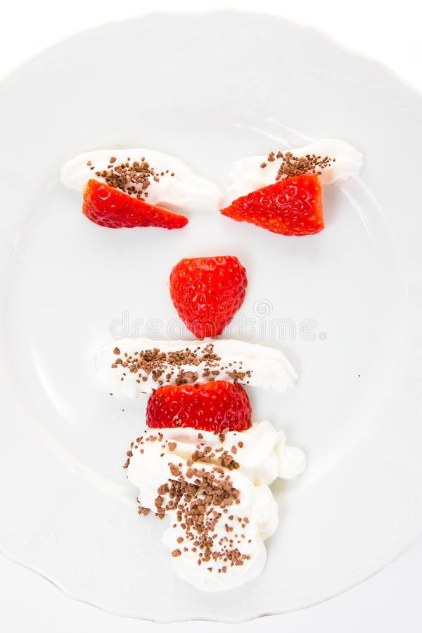 Emoticon make from strawberries saying - mind your body weight royalty free stock photography
