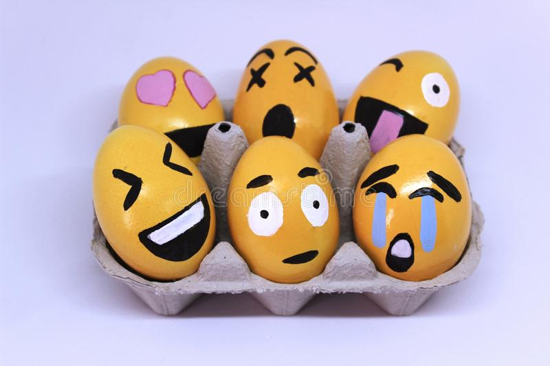 Emoticons Easter Eggs. On egg-cup and white background stock image