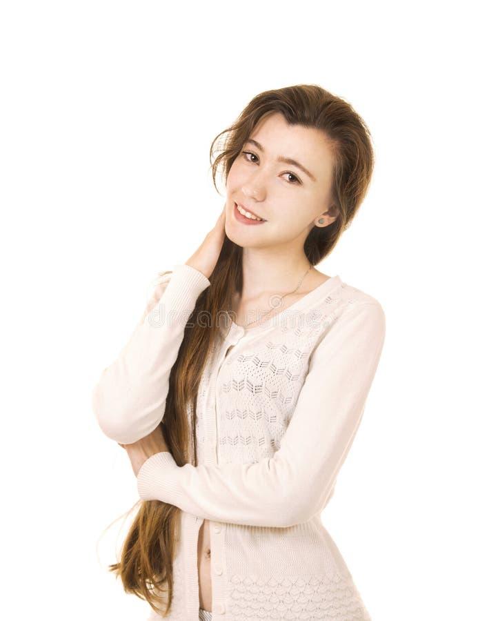 Emoties van een mooi meisje met lang haar, in een wit jasje stock fotografie