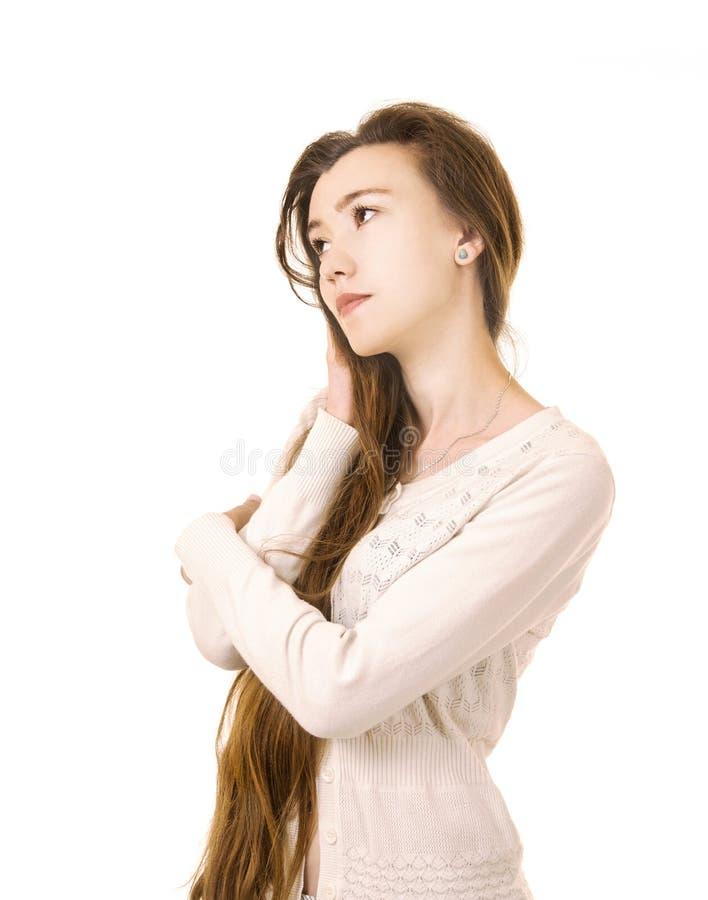 Emoties van een mooi meisje met lang haar, in een wit jasje royalty-vrije stock foto